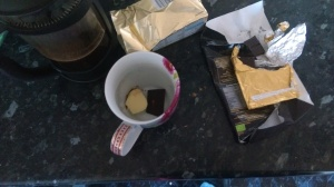 Butter, some dark chocolate (I prefer Green and Blacks) melted and mixed in with some steaming hot coffee. Yum- meee!